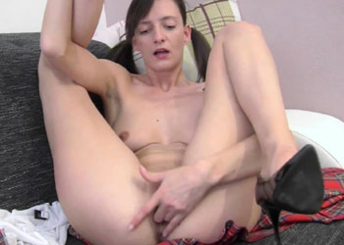 Horny hottie Laura fingers her twat